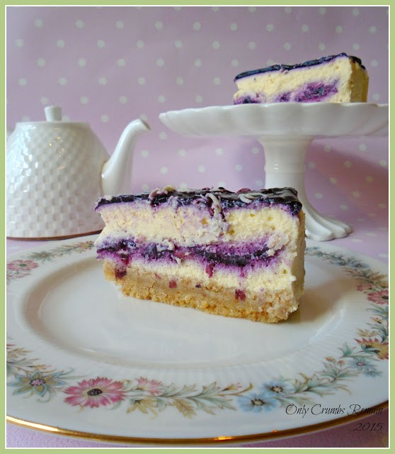 This recipe for a baked bilberry & white chocolate cheesecake dessert is constructed in such a way as to bring colour contrast when served.