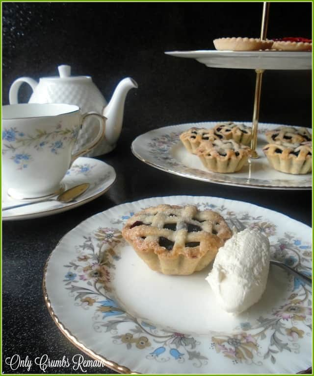 Afternoon Tea with fruit tarts with a lattice crust