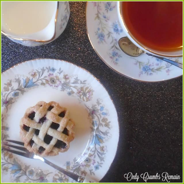 Individual bilberry fruit tart with a lattice crust