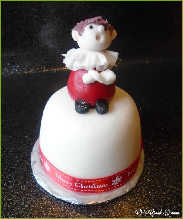 A fondant choir boy, perfect for topping Christmas cakes.