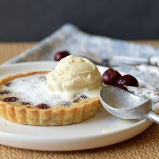 cherry clafoutis tart with scoop of ice cream on top