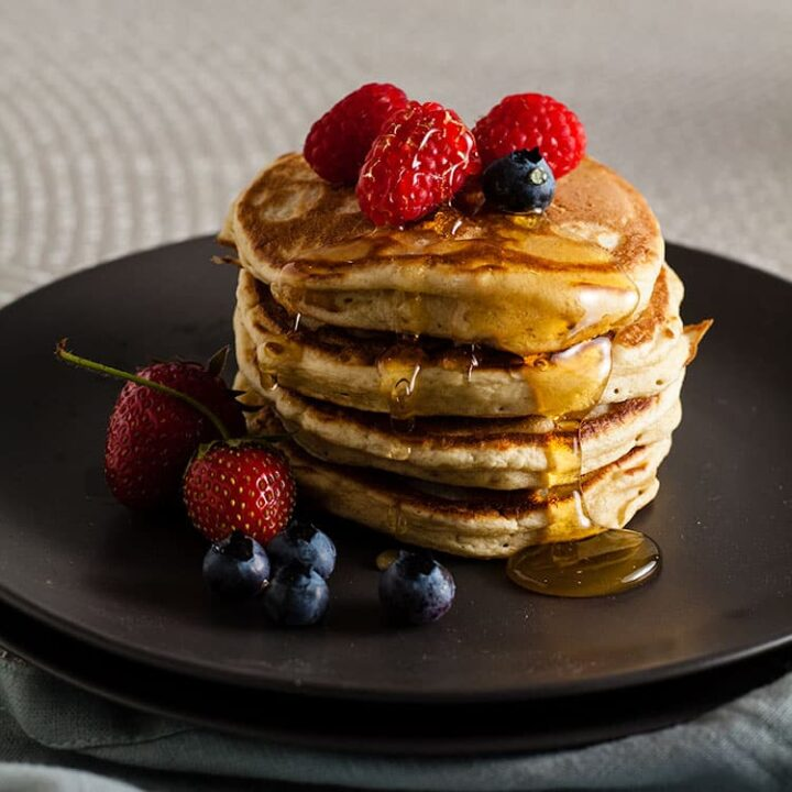 stack of sourdough pancakes on plate